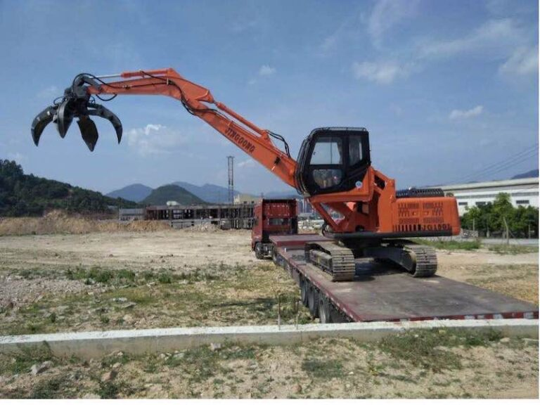 Scrap metal orange grab excavator